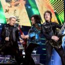 Singer Billy Idol, musicians Steve Stevens and Billy Morrison perform onstage during the first ever iHeart80s Party at The Forum on February 20, 2016 in Inglewood, California.