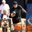 Fred Durst seen taking his son Dallas to get some pumpkins for Halloween (2009)