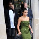 Kim Kardashian and Kanye West after having lunch at the restaurant L'Avenue in Paris, France (June 17)