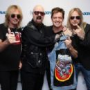 Glenn Tipton, Rob Halford and Richie Faulkner along with host Jim Breuer attend SiriusXM's Town Hall series with Judas Priest on July 8, 2014 in New York City.