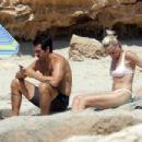 Robin Wright in Bikini at the beach in Formentera - 454 x 303