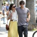 Walking down the street on Saturday (May 28) in Venice, Calif.