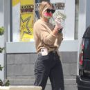 Sofia Richie wears a floral print mask at Chevron gas station in Malibu