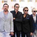 Simon Le Bon, John Taylor, Roger Taylor and Nick Rhodes of Duran Duran attend the Nordoff Robbins 02 Silver clef Awards at The Grosvenor House Hotel on July 3, 2015 in London, England.