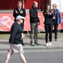 Duchess Catherine, Prince William and Prince Harry attend Virgin Money London Marathon