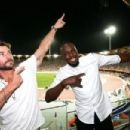 Usain Bolt And Chris Hemsworth Attend The Commonwealth Games