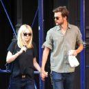 A smitten looking Dakota Fanning and her boyfriend Jamie Strachan go hand in hand for a stroll around New York City - 357 x 594