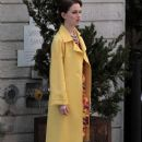 Leighton Meester waves to the cameras as she films a scene for