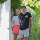 Margot Robbie – In white shorts see outside her home in Los Angeles