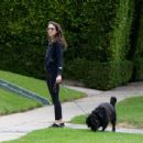 Troian Bellisario – Out for a walk with her dog in Los Angeles
