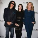 Gene Simmons' wife Shannon Tweed reveals she cut her leg falling down slippery stairs...but it doesn't slow her down at DailyMail.com people's choice awards after party