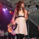 Zooey Deschanel Takes the Stage at Bonnaroo