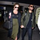 Chrissy Teigen and John Legend are seen at LAX