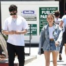 Madison Beer in Daisy Dukes with Zack Bia at South Beverly Grill in Beverly Hills