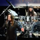 Musicians Ozzy Osbourne (L) and Tommy Clufetos perform onstage at the 10th annual MusiCares MAP Fund Benefit Concert at Club Nokia on May 12, 2014 in Los Angeles, California.