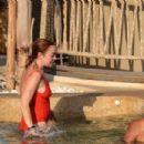 Lindsay Lohan – In red swimsuit on Mykonos Island - 454 x 302