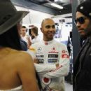 Lenny Kravitz talks with Lewis Hamilton and Nicole Scherzinger as he visits the F1 Paddock on March 16, 2012 in Melbourne, Australia