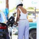 Vanessa Hudgens in White Crop Top at a gas station in Los Angeles