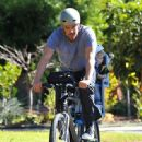 Josh Duhamel is spotted enjoying a bicycle ride with his growing son Axl on January 8, 2016 in Brentwood