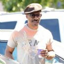 Eddie Murphy stops by Coffee Bean in Studio City, California with a friend to get his caffeine fix on September 10, 2014
