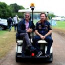 Infiniti Red Bull Racing Team Principal Christian Horner and David Coulthard are transported in a buggy to a campsite appearance after qualifying ahead of the British Formula One Grand Prix at Silverstone Circuit on July 5, 2014 in Northampton, United Kin - 454 x 310