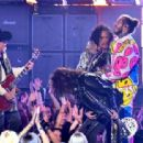 Aerosmith and Post Malone perform onstage during the 2018 MTV Video Music Awards at Radio City Music Hall on August 20, 2018 in New York City - 454 x 312