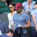 Love all! Super-chic Irina Shayk and Bradley Cooper look sweet while snuggling up as they appear more interested in each other than the tennis at Wimbledon