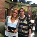 Miley Cyrus visited Jason Earles on the set of his Disney show, Kickin' It. She also returned to the studio - 454 x 608
