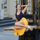 Adriana Lima in Bright Yellow Frilly Skirt on a photoshoot in NYC