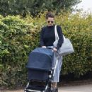 Felicity Jones – Takes her newborn for a stroll in London