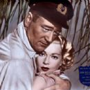 Lana Turner and John Wayne