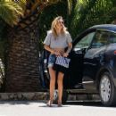 Doutzen Kroes in a cropped top and denim shorts in Ibiza - 454 x 363