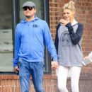 Holding on tight! Leonardo DiCaprio and new love Kelly Rohrbach stroll hand-in-hand in NYC in rare public display of affection