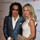 Musician Paul Stanley of KISS and Erin Sutton attend the Spirit of Excellence Awards 2014 at the Hyatt Regency Century Plaza on September 23, 2014 in Century City, California - 413 x 594