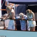 Queen's Roger Taylor uses a pole and shoots an AIRGUN at jellyfish whilst on a boat ride with his wife and children during sun-soaked holiday in Spain, 31 May 2019 - 454 x 303