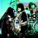 Musicians Gene Simmons, Tommy Thayer and Eric Singer of KISS perform onstage during the 23rd Annual Race To Erase MS Gala at The Beverly Hilton Hotel on April 15, 2016 in Beverly Hills, California - 454 x 316