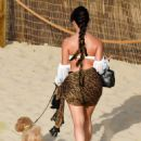 Demi Rose – In bikini on the beach with her pooch Teddy in Ibiza - 454 x 605
