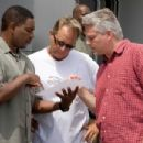 Director DAVID R. ELLIS (center) discusses a scene with actor MYKELTI WILLIAMSON (left) and producer CRAIG PERRY (right) in New Line Cinema's horror film 'The Final Destination,' a Warner Bros. Pictures release. Photo by Jim Sheldon - 454 x 303