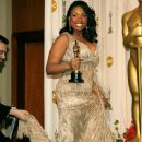 Best Supporting Actress winner Jennifer Hudson with her statuette at the 79th Annual Academy Awards - 370 x 594
