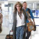 Steven Tyler carries a custom ukulele as he prepares to depart LAX (Los Angeles International Airport)