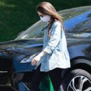Lily Collins – Visiting family house in Los Angeles