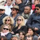 Leonardo DiCaprio and his friend Lukas Haas attend the French tennis Open round of 16 match at the Roland Garros stadium in Paris. Jo-Wilfried Tsonga of France plays against Viktor Troicki of Serbia, and Roger Federer of Switzerland over Gilles Simon of F - 454 x 290