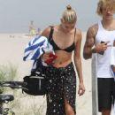Hailey Baldwin in Bikini Top with Justin Bieber on the beach in The Hamptons