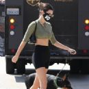 Kendall Jenner – Spotted with her doberman at Sunlife Organics in Malibu
