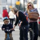 Laura Bailey Showing Her Daughter How To Ride A Bike