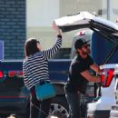 Alexandra Daddario and Zac Efron – Shopping for their dogs in Los Angeles