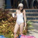 Dakota Johnson in White Swimsuit in Florida