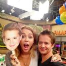 Miley Cyrus visited Jason Earles on the set of his Disney show, Kickin' It. She also returned to the studio - 454 x 605