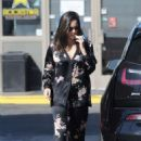 Olivia Munn – Spotted pumping gas in Los Angeles