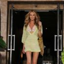 Candice Swanepoel leaves her hotel in a short dress and bikini top for a Victoria's Secret photo shoot in Miami